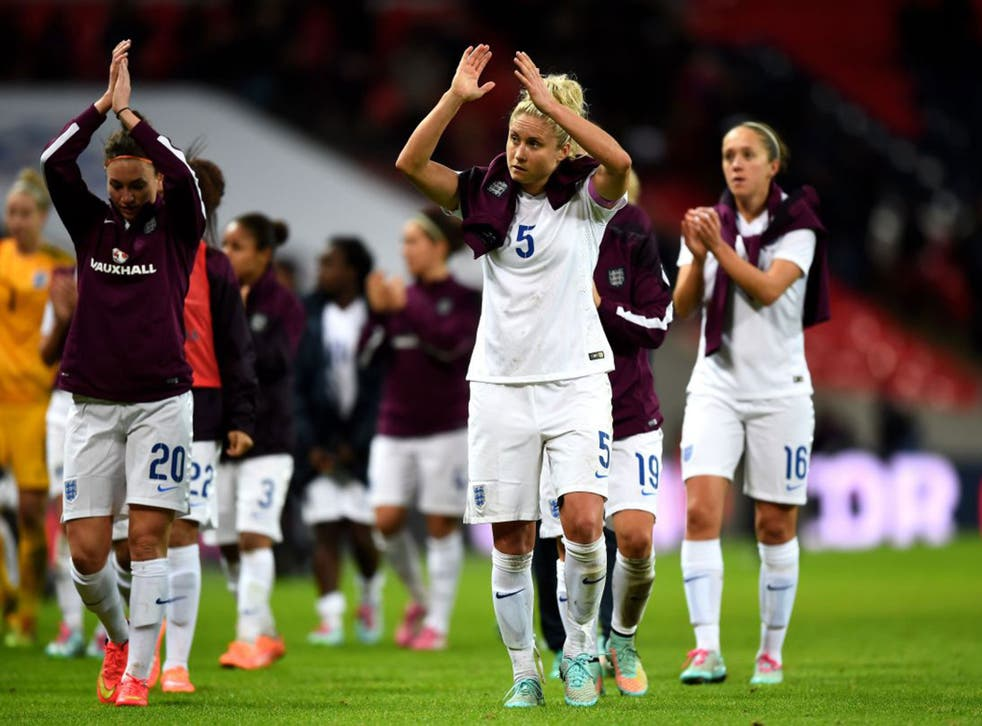 Dejected England players applaud the fans following their team's 3-0 defeat