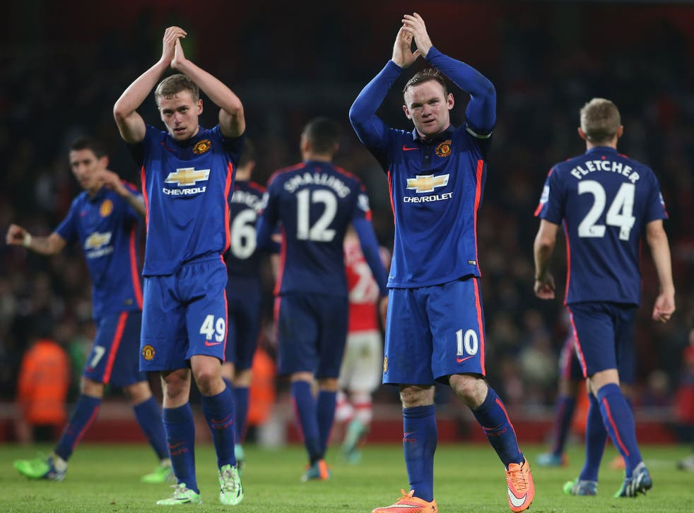 Wayne Rooney and James Wilson applaud the travelling Manchester United fans