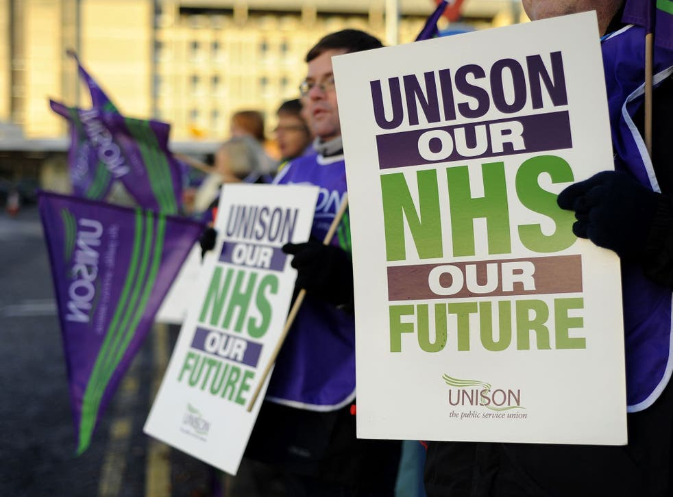 NHS health workers join the official picket line outside the Basingstoke and North Hampshire Hospital, 24 November 2014