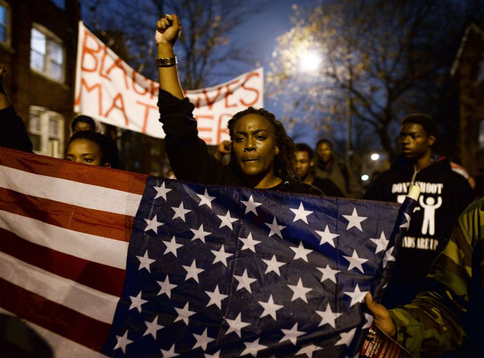 Protesters march in St Louis, Missouri, to put pressure on the grand jury to charge Officer Darren Wilson over the killing of Michael Brown