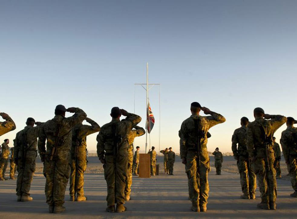 Garrison Sergeant Major, Andrew Stephens, lowers the Union flag for the last time at Kandahar Air base
