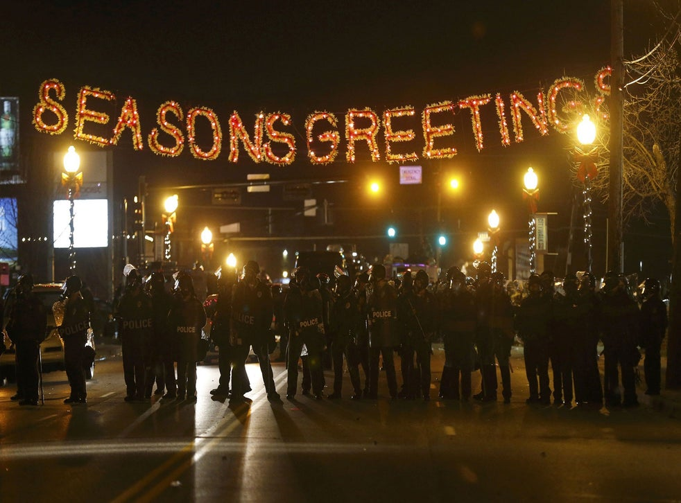 Ferguson riots: The most powerful images to emerge from protests ...