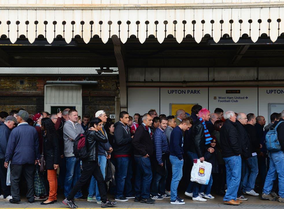 Fans arrive at Upton Park tube station.