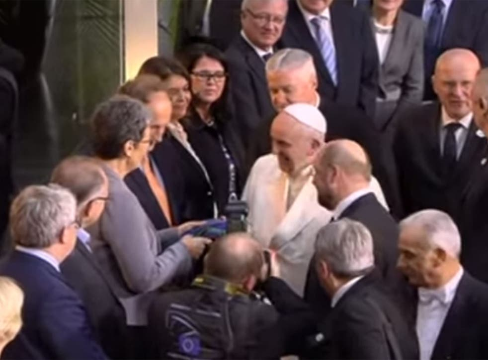 Ulrike Lunacek hands Pope Francis a rainbow scarf
