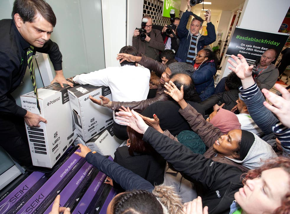 Shoppers try to grab items at the Asda store in Wembley