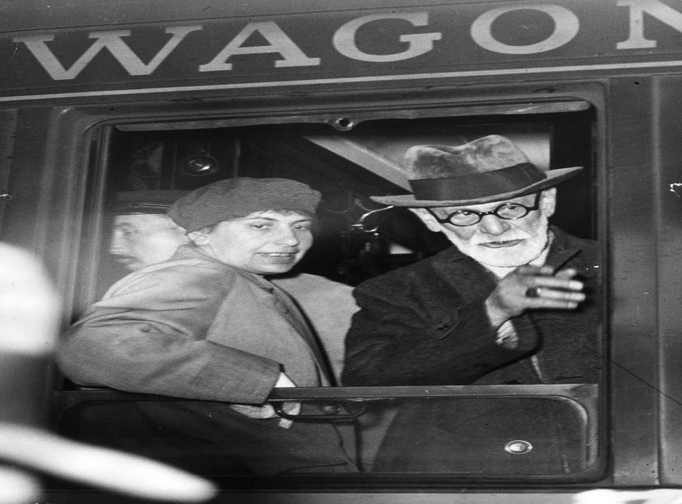 Anna Freud with her father Sigmund Freud at the window of a wagon-lit on arrival at the Gare de l'Est, Paris.