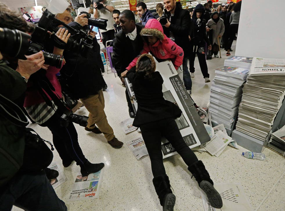 Shoppers wrestle over a television at an Asda superstore in Wembley
