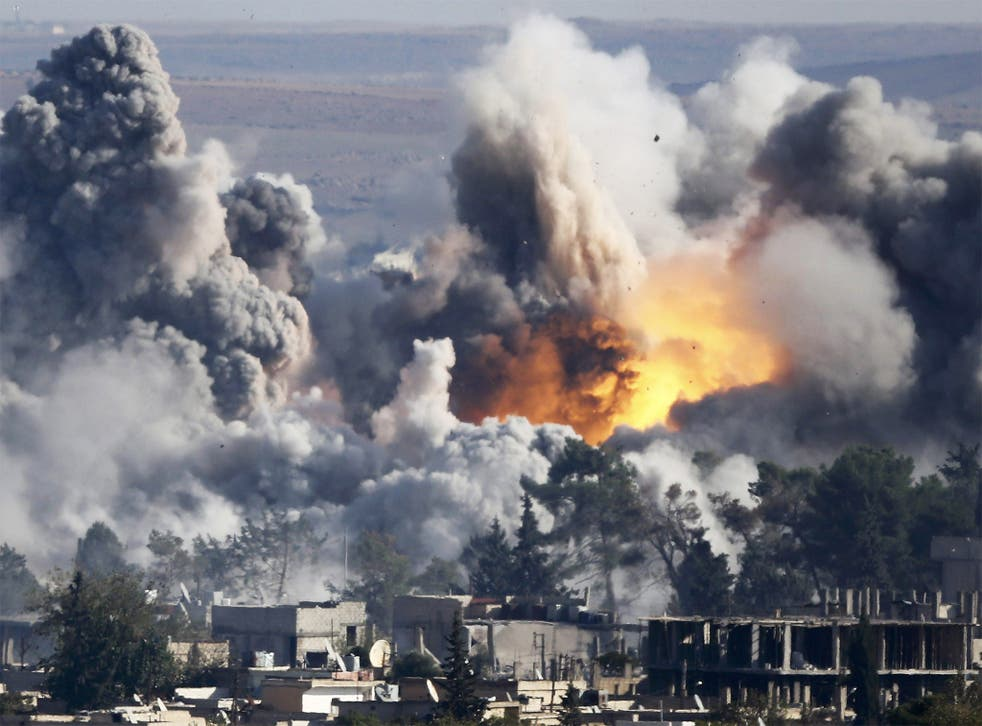 Smoke rises over Syrian town of Kobani after a recent airstrike