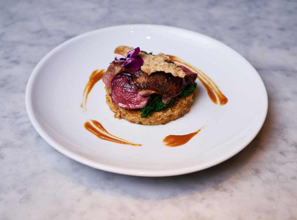 A pan-seared breast of wild mallard duck, celeriac rosti, saluteed kale, spiced cranberry and clementines at 'Pure Taste'