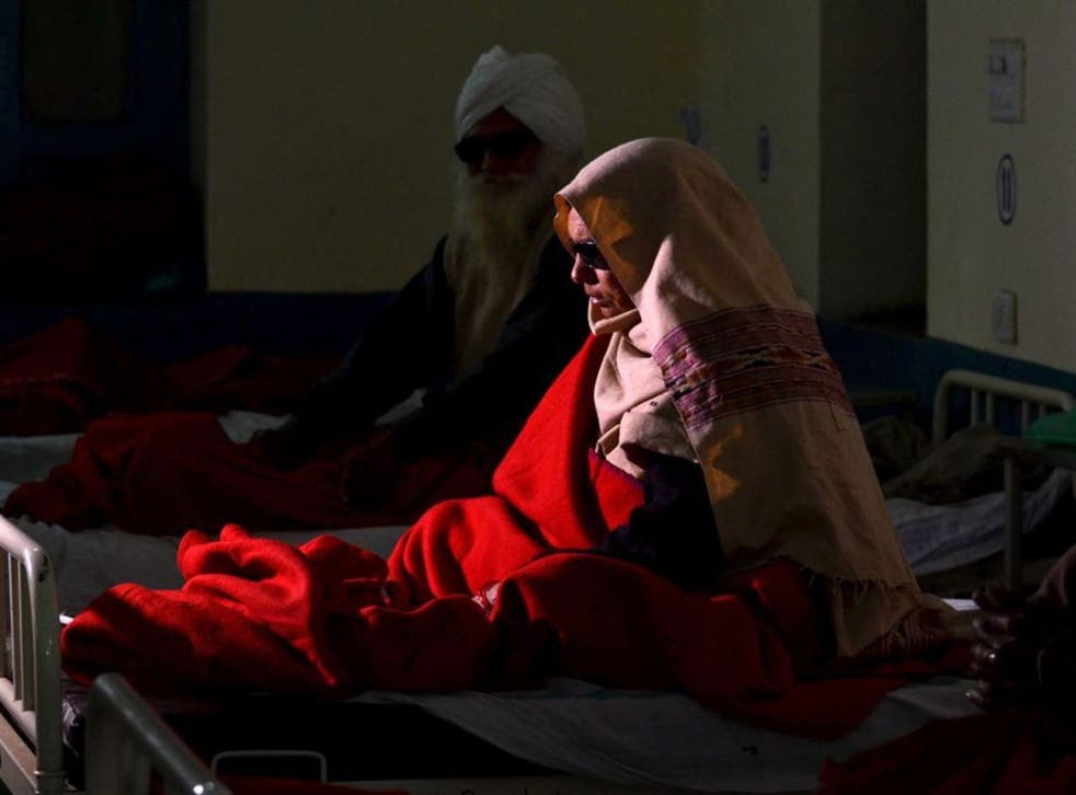 An elderly Indian patient who went blind following cataract surgery receives treatment at a hospital in Amritsar, India