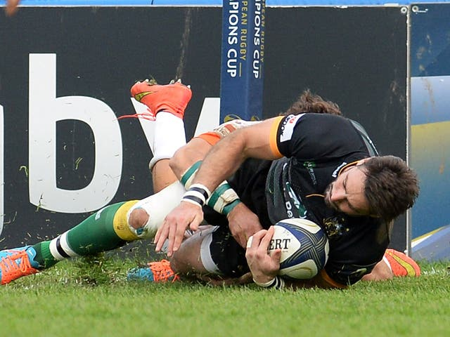 Ben Foden touches down to scores Northampton's third try against Treviso