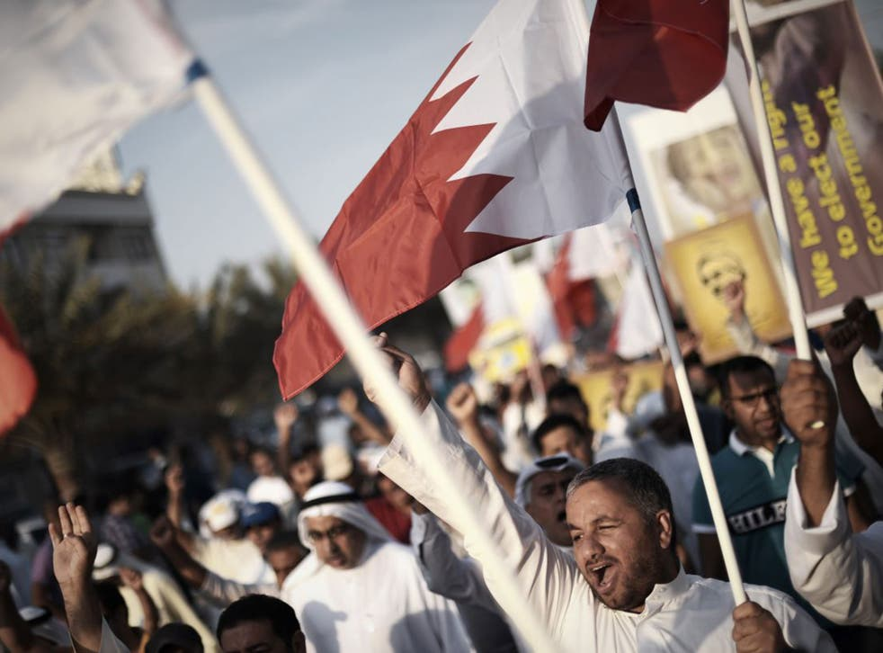 Bahrainis on an anti-government protest in May