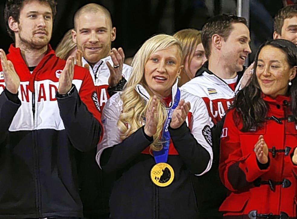 Breaking the ice: Kaillie Humphries (centre) piloted a men's four-man bobsleigh to bronze at the Canadian Championships in Calgary last month, showing that mixed teams can work