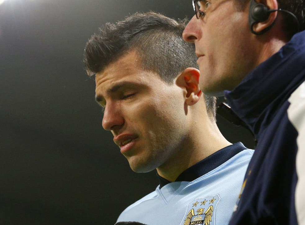 Sergio Aguero in tears as he leaves the pitch injured
