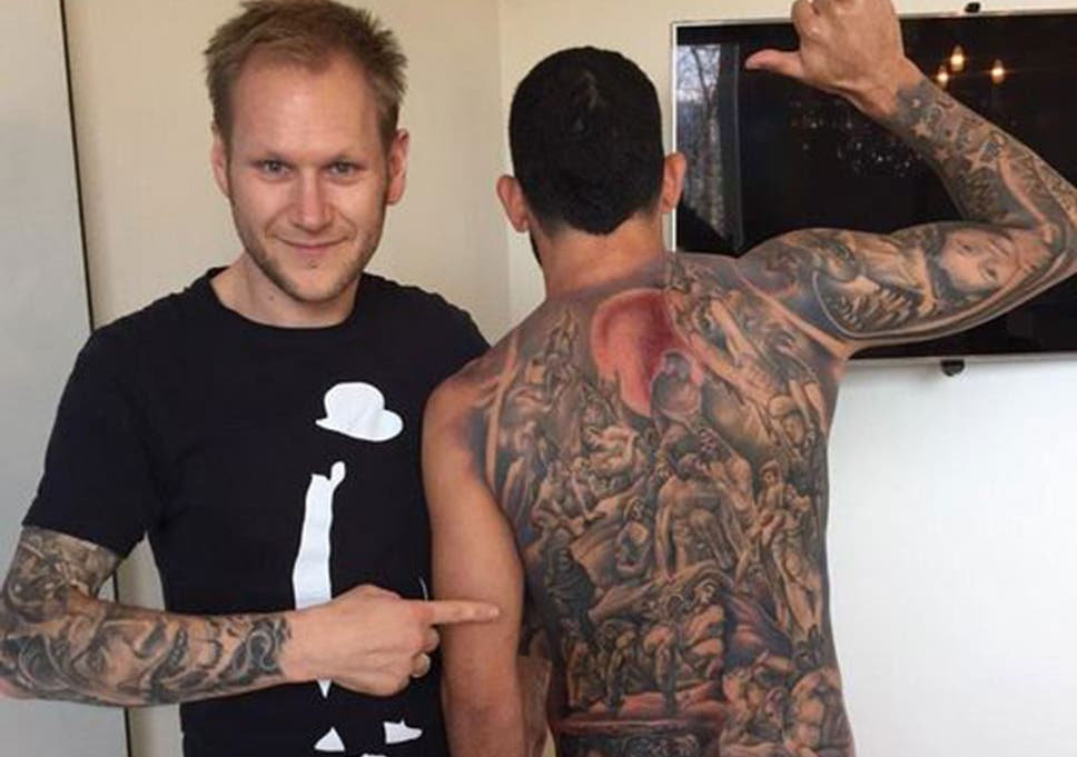 d79a2fd93bf Carlos Tevez tattoo  Juventus star gets giant work covering the whole of  his back