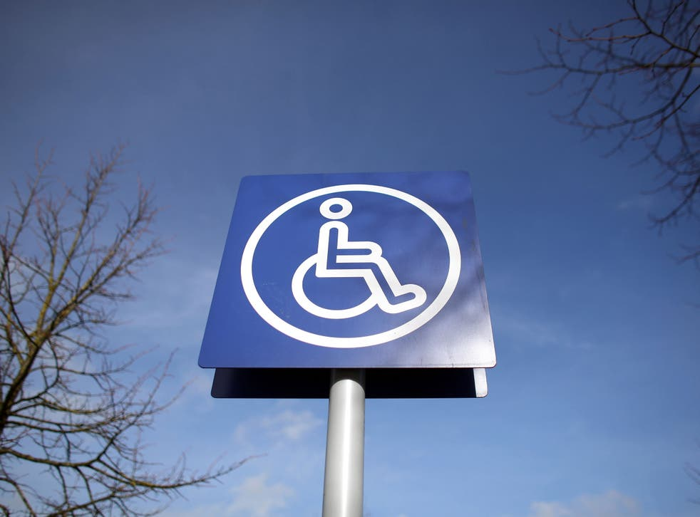 A sign is displayed above a disabled car parking bay