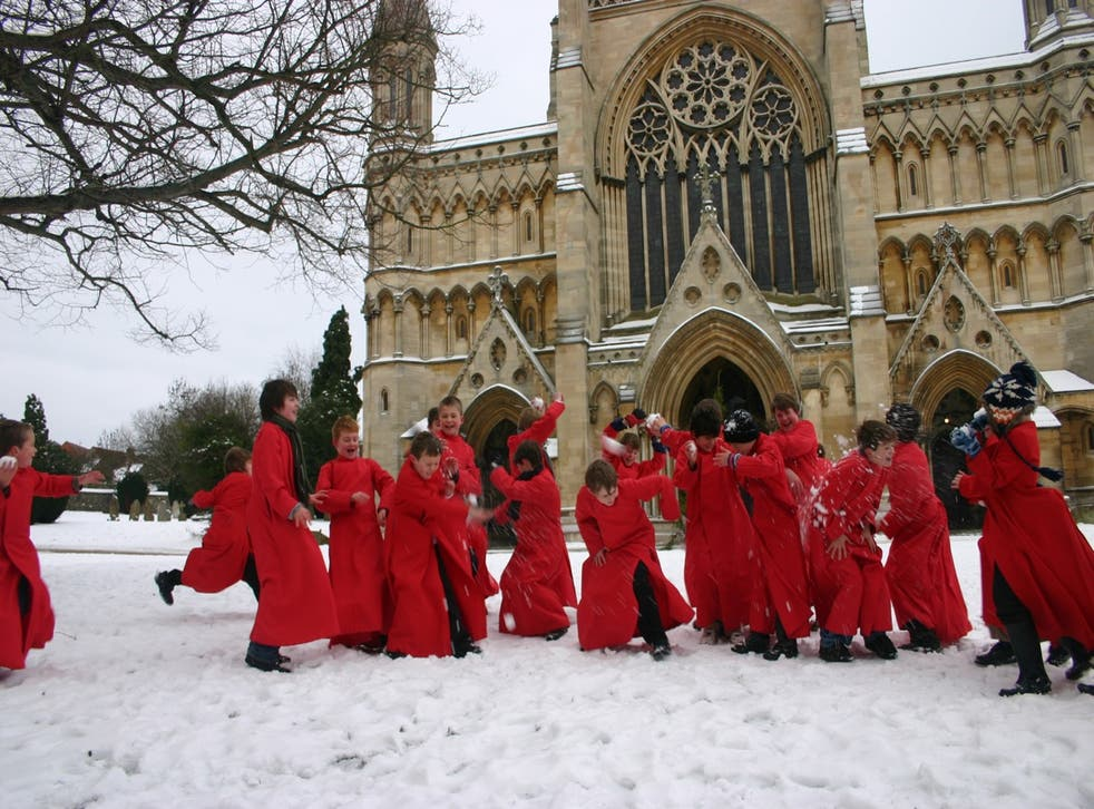 St Albans Cathedral Choristers taking time out from their rehearsals for some snowballing