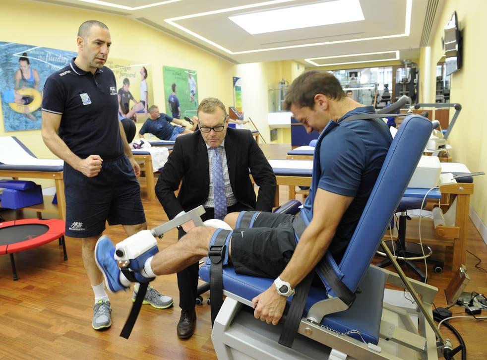 Phil Batty with Harley Street colleague Marco Zanobbi working with Leyton Orient footballer Gary Sawyer