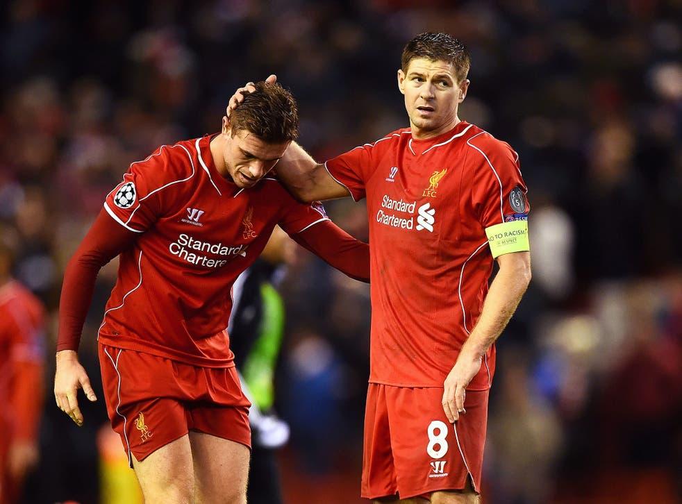 Dejected Liverpool players Jordan Henderson and Steven Gerrard