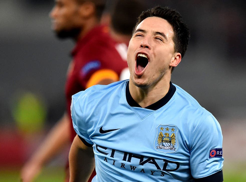 Samir Nasri cannot contain his delight after putting City 1-0 ahead