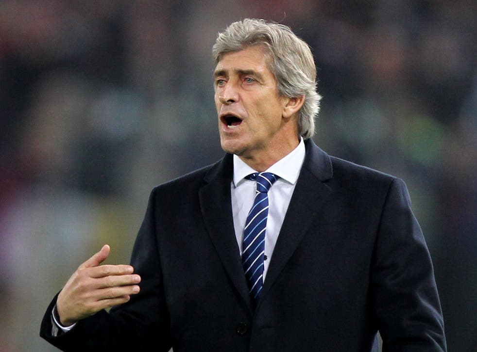 Manuel Pellegrini reacts on the touchline in Rome