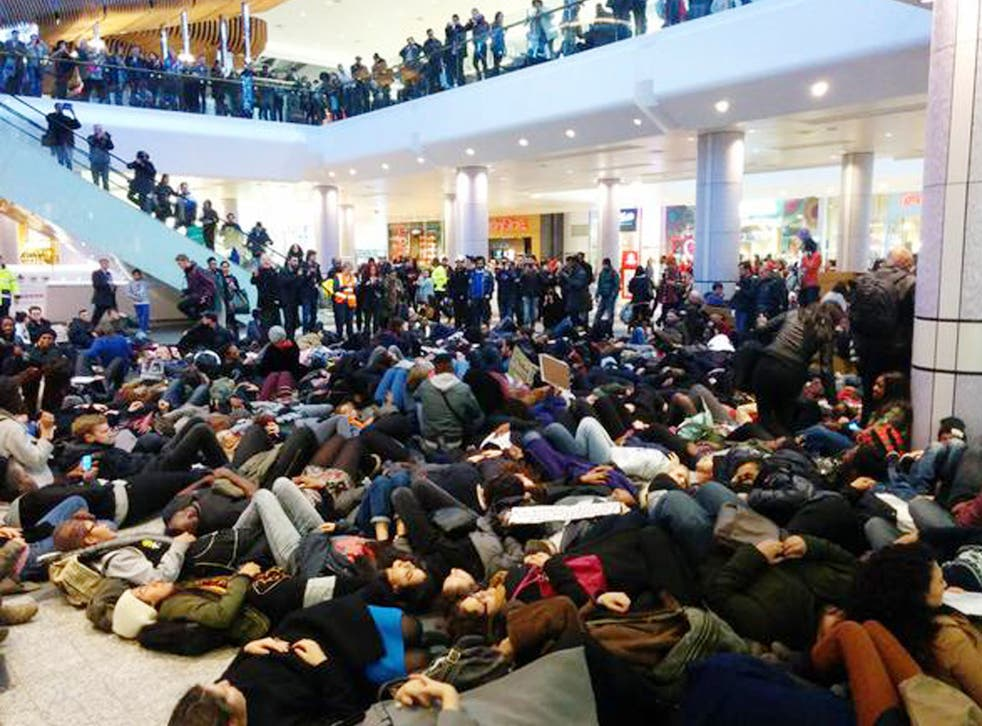 """Handout photo courtesy of Areeb Ullah of protesters at Westfield Shopping Centre at Shepherds Bush as they hold a """"die-in""""  in memory of Eric Garner"""