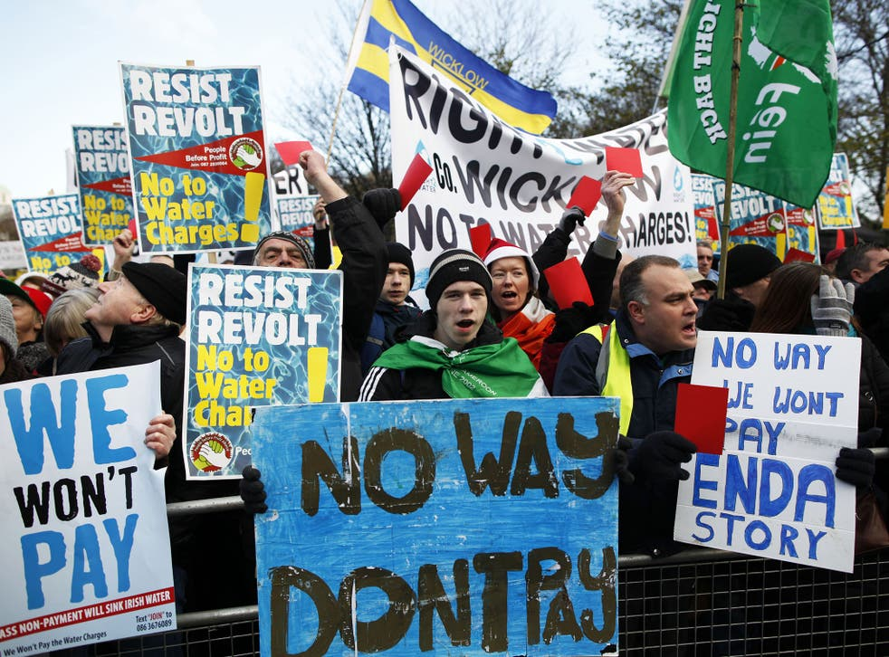 Water tax protesters demonstrate close to government buildings in Dublin city centre