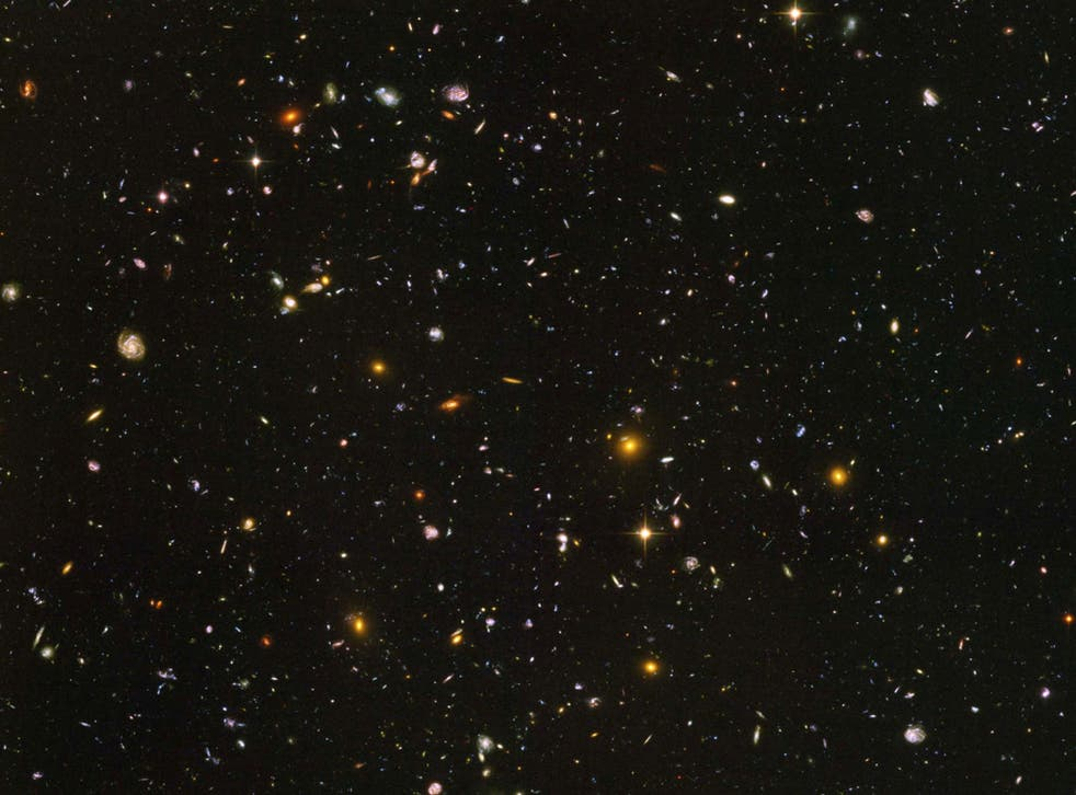 A photo from one of Hubble's deepest looks into the visible universe, showing some of the first galaxies created during the Big Bang. Photo: NASA/ESA/S. Beckwith(STScI) and The HUDF Team