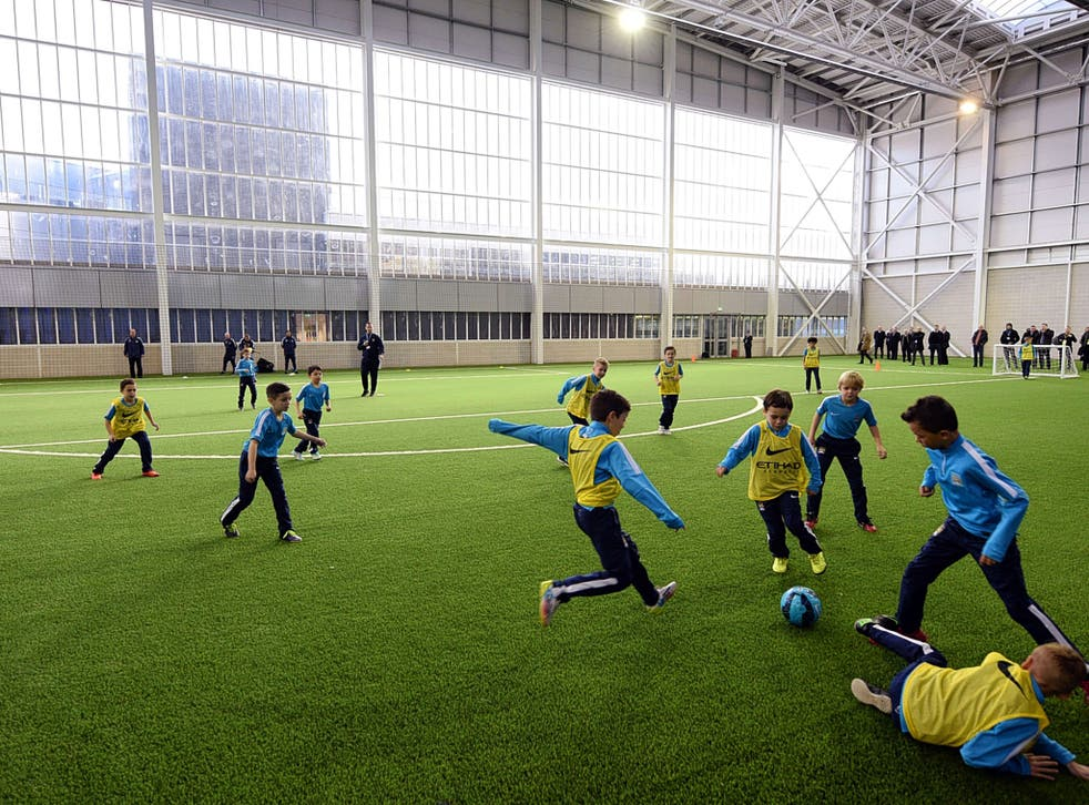 Young players enjoying the facilities at Manchester City's new £200m academy which opened this week