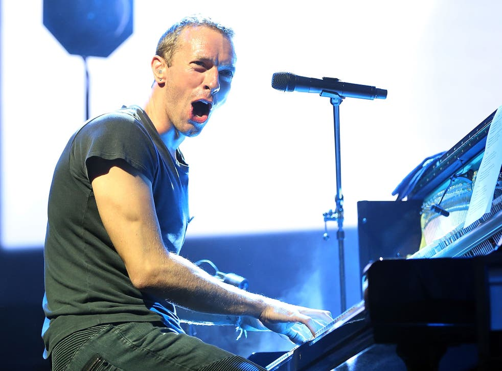 Chris Martin of Coldplay performs live