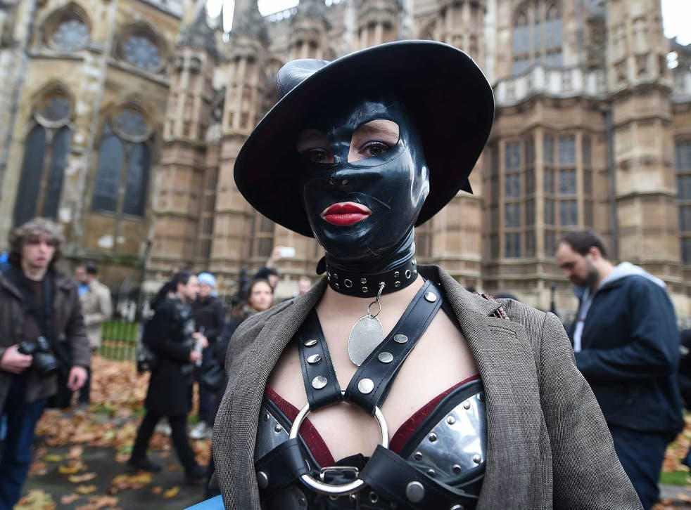 One of the 'face-sitting' protesters outside parliament