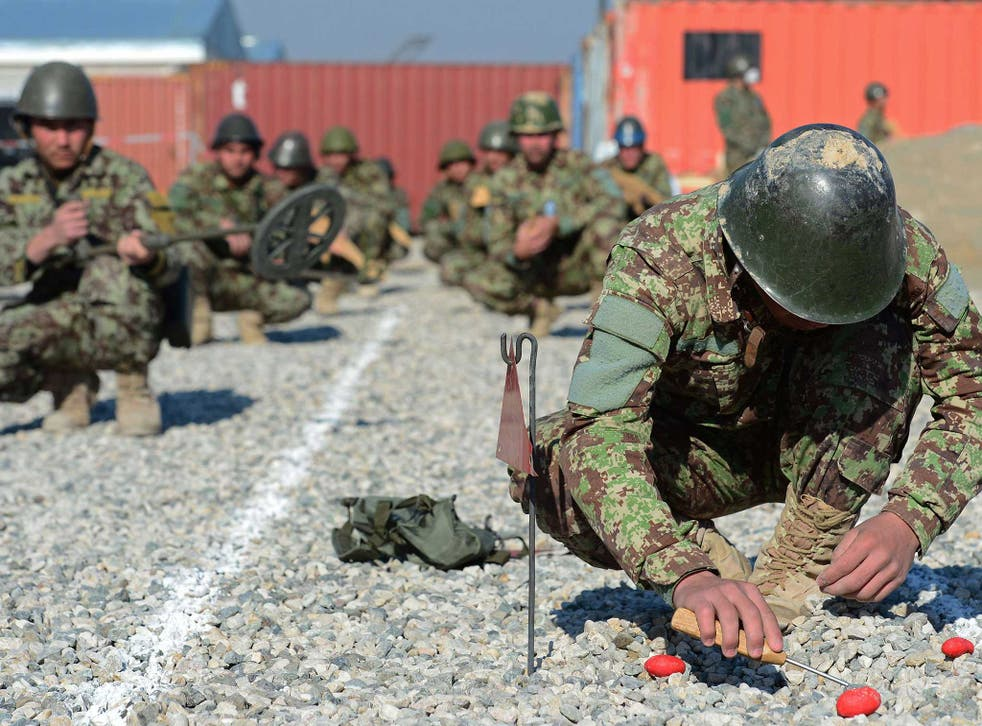A member of the Afghan National Army practises detonating a mine