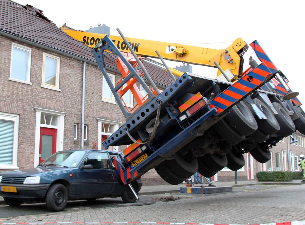 A general view of the crane which fell on to the roof of a house in IJsselstein, central Netherlands, 13 December 2014. The incident ocurred when a man tried to surprise his girlfriend by proposing from the top of the crane, which then toppled on to the h