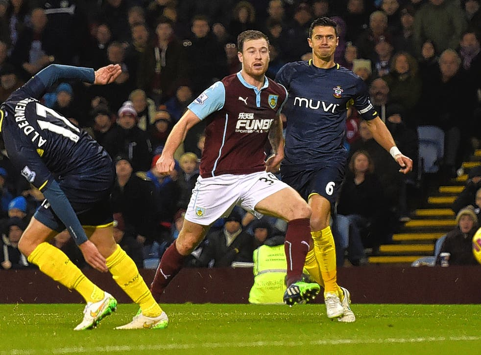 Jose Fonte watches on as Ashley Barnes