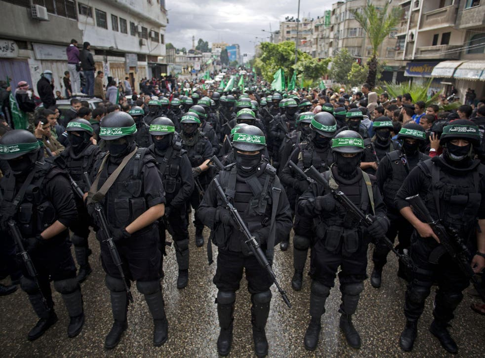 Hamas gunmen display their military skills during a rally to commemorate the 27th anniversary of the militant group