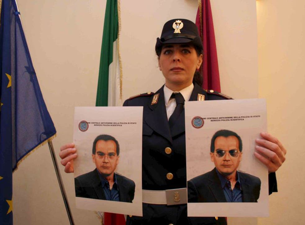 A police officer shows two pictures of Matteo Messina Denaro, nicknamed Diabolik, during a press conference in Palermo, Sicily (EPA)