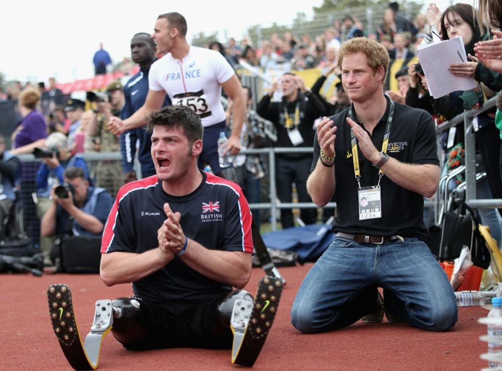 Dave Henson pictured with Prince Harry cheering on the British team at the 2014 Invictus Games