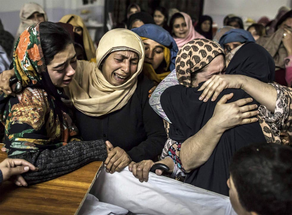 Women mourn the death of a relative who was killed during the attack on the Army Public School, in Peshawar