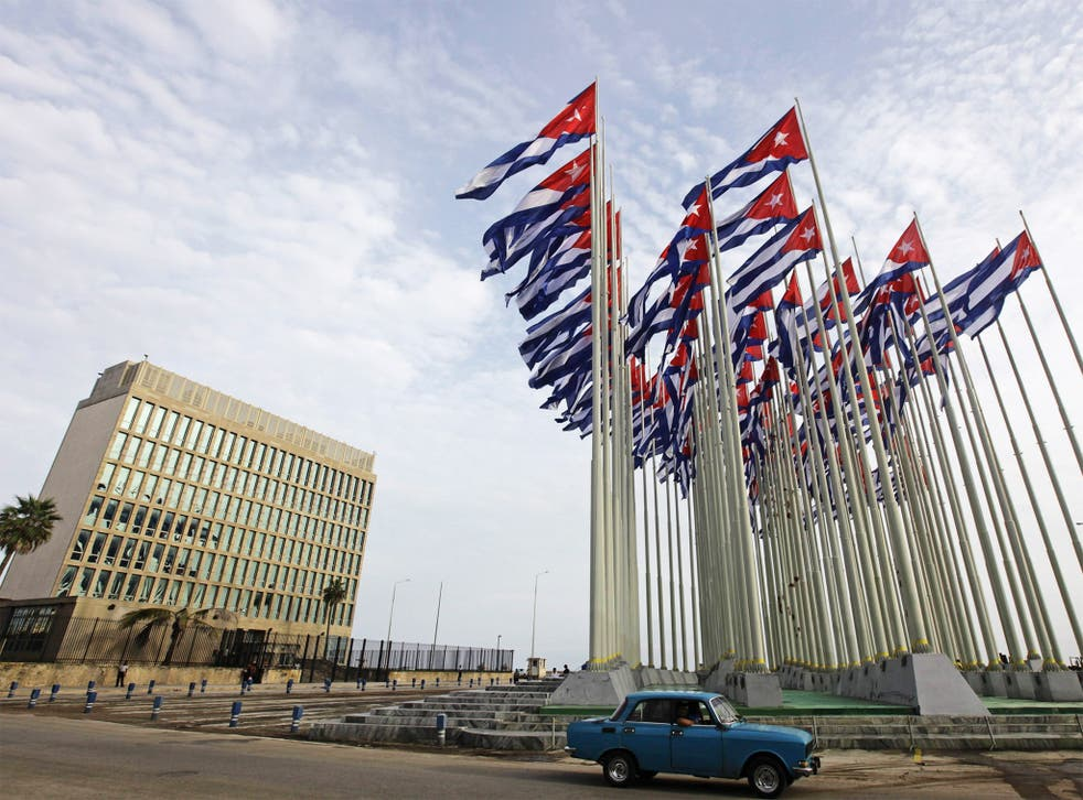 A car drives past the building of the US Interests Section, in Havana