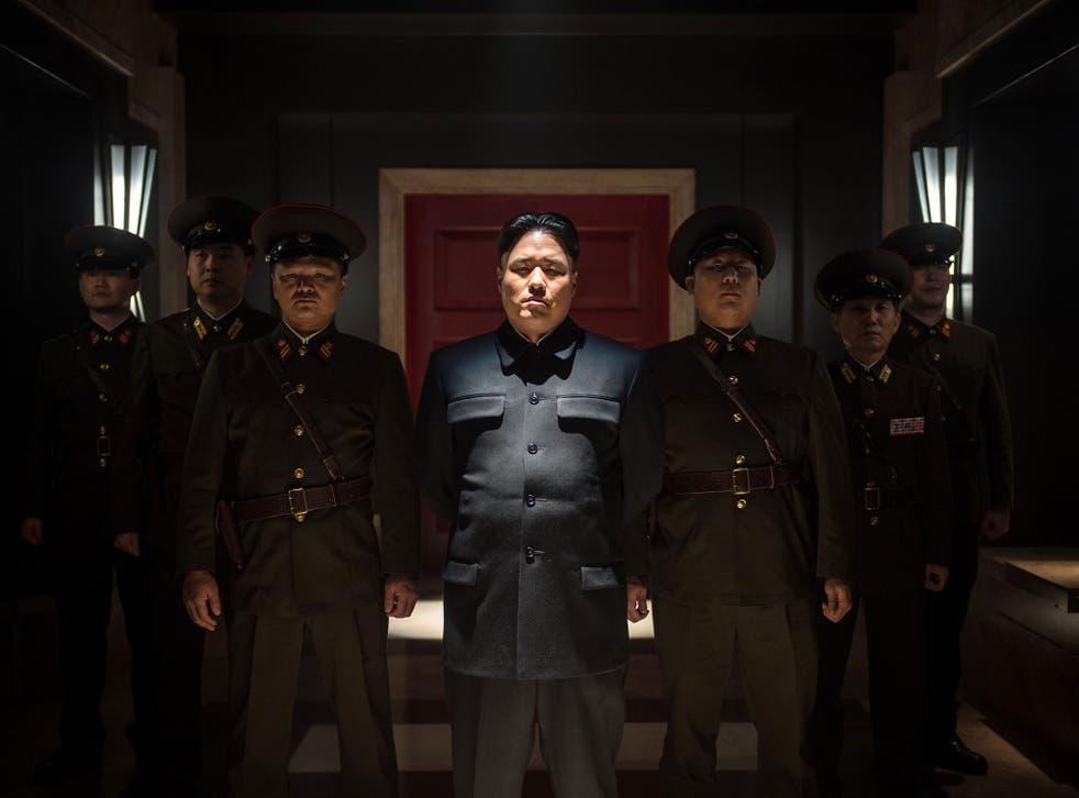 A still from The Interview, showing Randall Park as Kim Jong-Un