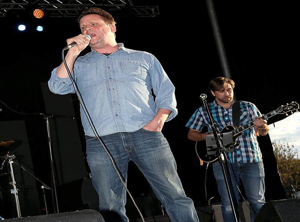 Mark Kozelek (L) of Sun Kil Moon performs during Day 1 of Fun Fun Fun Fest at Auditorium Shores on November 7, 2014 in Austin, Texas.