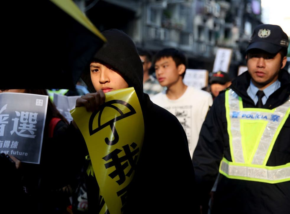 A pro-democracy protester in Macau calls for free leadership elections