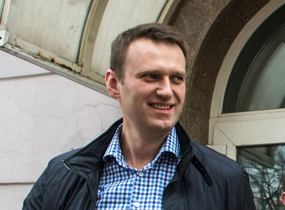 Russian opposition leader Alexei Navalny leaves a court building after a hearing in his Yves Rocher's case in Moscow, on March 7, 2014