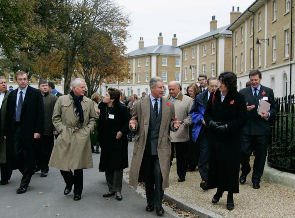 Prince Charles in Poundbury, his experimental new town in Dorset which has been dismissed as a 'retro-kitsch fantasia'