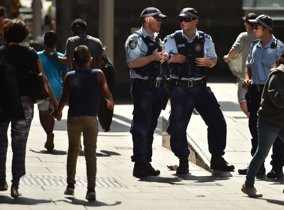 Police patrol the street in Sydney's central business district on December 24, 2014.