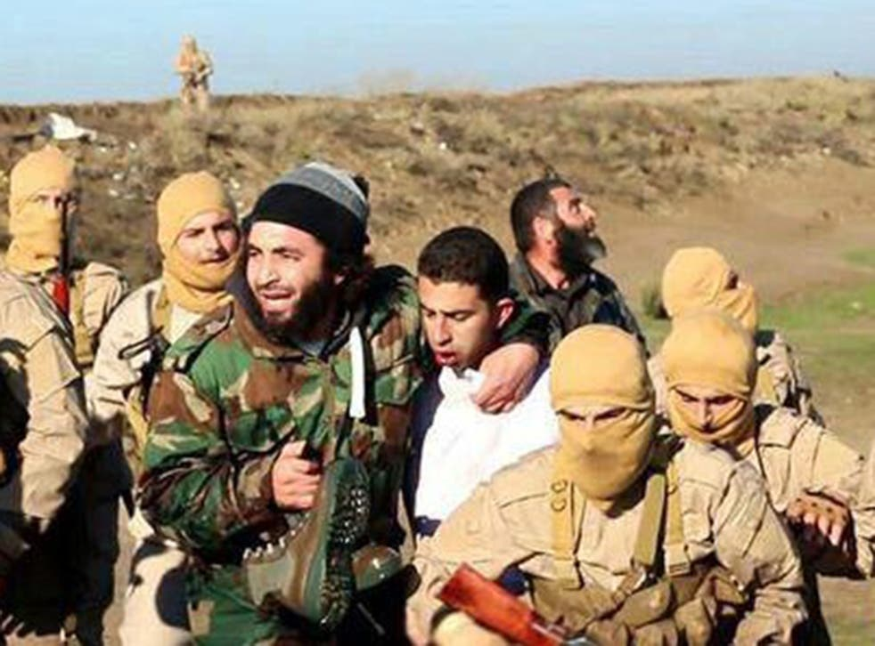 Members of the Islamic State group with captured the pilot, who is wearing a white shirt