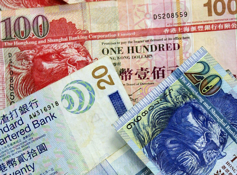 Hong Kong Dollars spilled out onto a road on Christmas Eve
