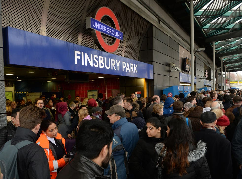Travellers are locked out of Finsbury Park station, London, where they were directed to go as trains in and out of King's Cross have been cancelled