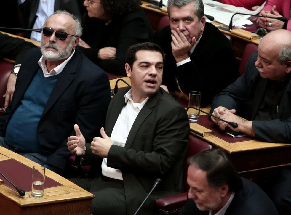 Syriza party leader Alexis Tsipras, centre, in parliament on Monday (AFP/Getty)