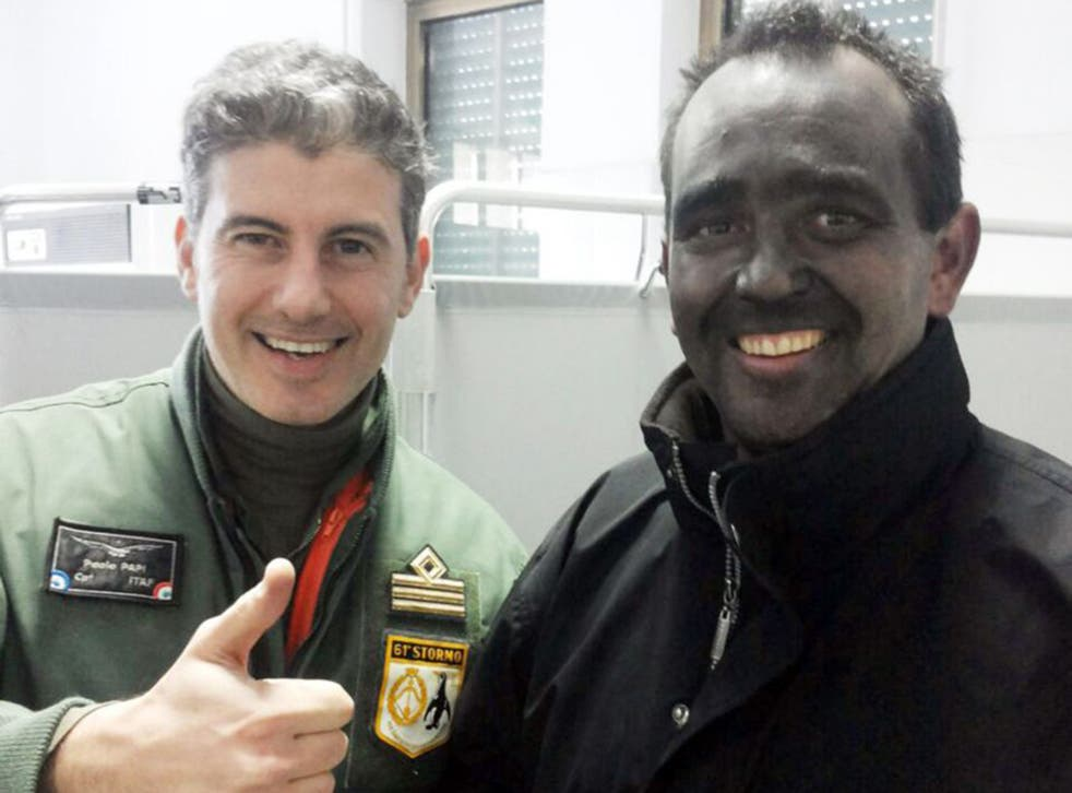 Briton Nick Channing-Williams, covered in soot, with Captain Paolo Papi of the Italian Air Force (PA)